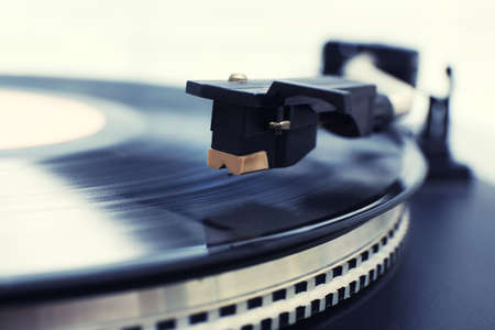 listen to music: Gramophone with a vinyl record, closeup