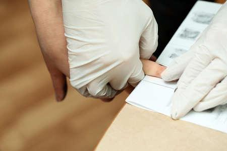 accused: Taking fingerprints