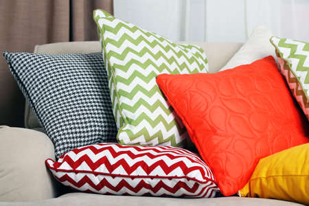 bright colors: Sofa with colorful pillows in room