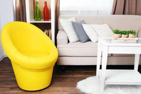 comfortable chair: Modern interior with comfortable sofa and chair in room