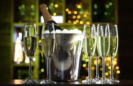 clear bottle: Glasses of champagne on bar background Stock Photo