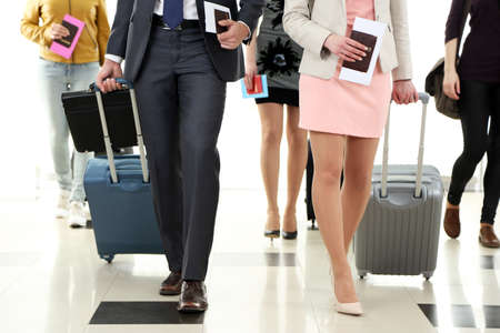 people travelling: People with suitcases in airport Stock Photo