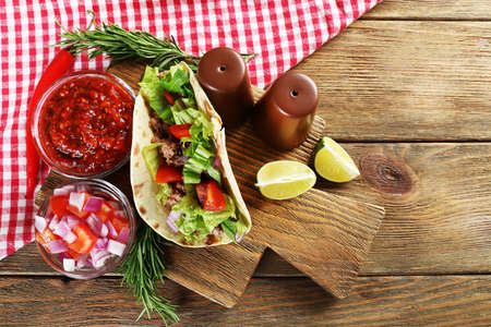 mexican food: Mexican food Taco on wooden cutting board, closeup
