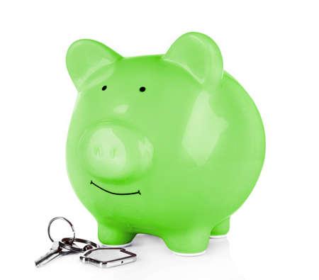 key box: Piggy bank style money box with key isolated on a white Stock Photo