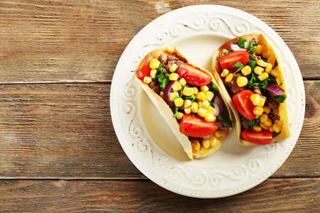 mexican food: Mexican food Taco in plate on wooden table, top view