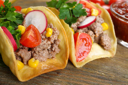 mexican food: Mexican food Tacos on wooden table, closeup
