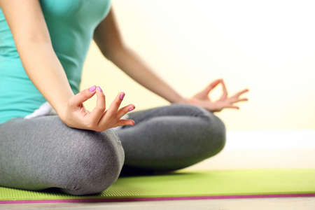meditation room: Hand yoga gesture on bright background