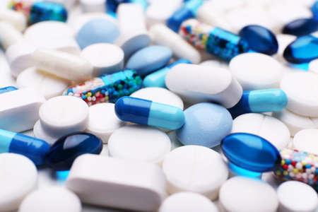 white pills: Pile of pills, closeup