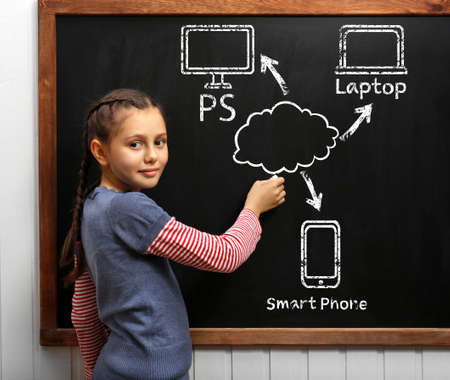 Girl drawing cloud network on the chalkboard