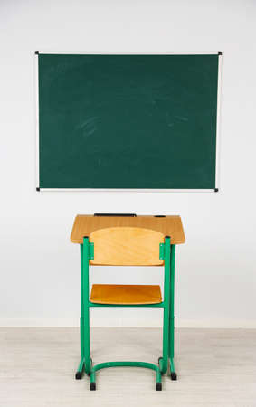 schooldesk: Blackboard and wooden desk with chair in class Stock Photo