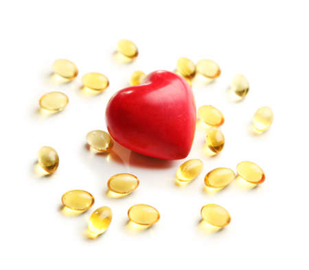 cod oil: Red heart and cod liver oil, isolated on white