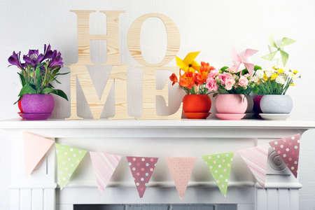 vibrant background: Beautiful flowers in ornamental flowerpot on mantelpiece