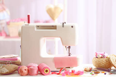 textile machine: Sewing machine on table in workshop Stock Photo