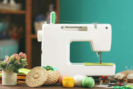 machine: Sewing machine on table in workshop Stock Photo