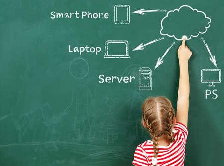 Little girl drawing cloud network on the chalkboard Stock Photo