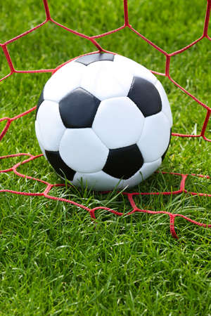outfield: soccer ball in goal Stock Photo