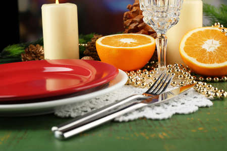 appointments: Table appointments with pieces of orange and Christmas decoration background