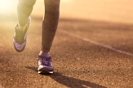 of movement: Sports woman legs in running movement