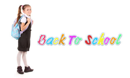 Portrait of beautiful little girl in school uniform with backpack isolated on white background