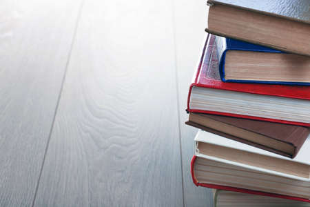 Stack of books on wooden background Stock Photo