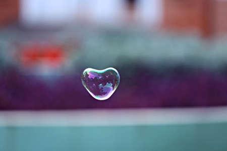 Soap bubble in heart shape outdoor