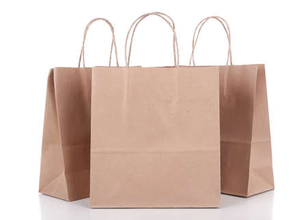 brown paper bags: Paper shopping bags isolated on white Stock Photo