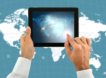 hands holding globe: Human holding tablet pc  with world map and network on screen