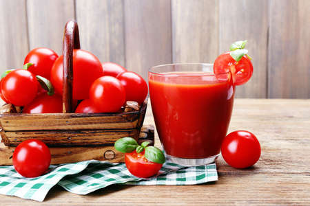 cherry tomato: Glass of tomato juice with vegetables on wooden background