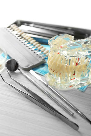 prosthesis: Fake teeth, prosthesis and dental instruments on table background