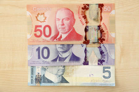 Canadian dollars on wooden table Stock Photo