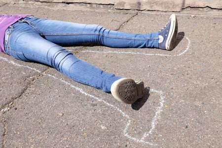 strangle: Dead woman laying on asphalt