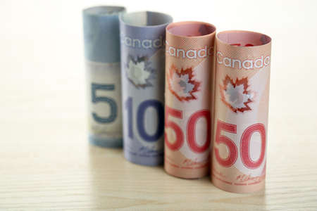 Canadian dollars on wooden table