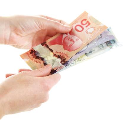 femme, mains, avec des dollars canadiens, isolé sur blanc