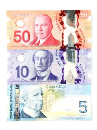 fondos violeta: Dólares canadienses, aislado en blanco Foto de archivo