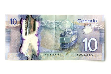 fondos violeta: 10 Dólar canadiense, aislado en blanco Foto de archivo