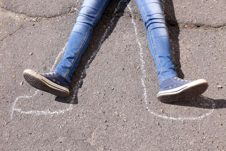swooned: Dead woman laying on asphalt