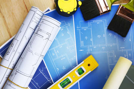 architecture plans: Construction instruments, plan and brushes on wooden table background
