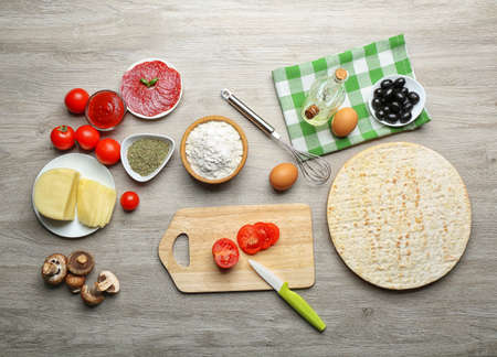view top: Ingredients for cooking pizza on wooden table, top view