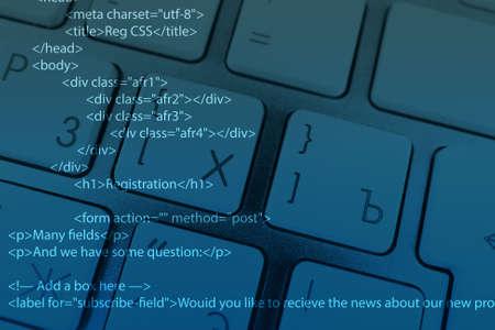 operand: Computer keyboard with program code Stock Photo