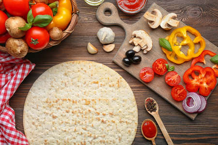 eating pizza: Ingredients for cooking pizza on wooden table, top view