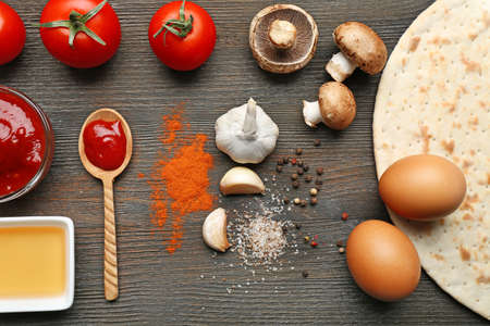 spice cake: Ingredients for cooking pizza on wooden table, top view