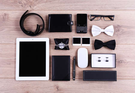 woman tie: Set of black and white accessories on wooden table, top view