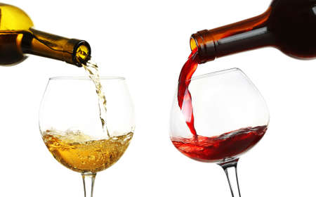 White and red wine pouring in glasses, isolated on white Reklamní fotografie