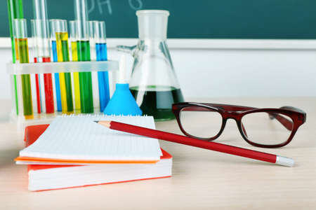 teaching material: Desk in chemistry class with test tubes close up