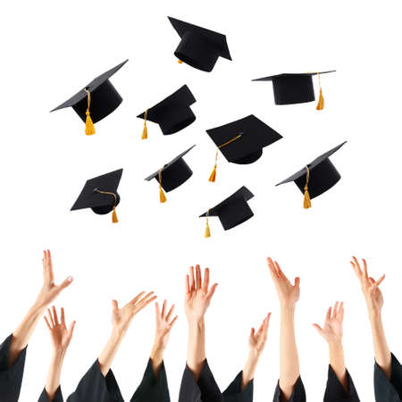 egresado: Graduates hands throwing graduation hats , isolated on white