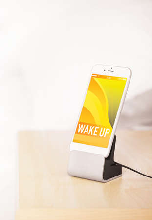 nightstand: Smart phone on nightstand in bedroom