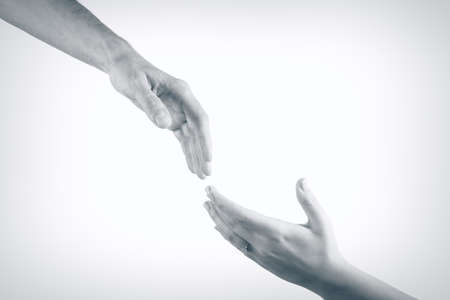 sociability: Two hands reaching toward each other. Helping concept. Vintage tone