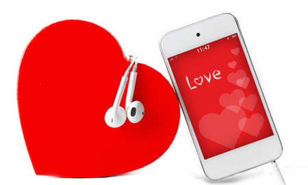 screensaver: Headphones with heart and phone with romantic screensaver isolated on white Stock Photo