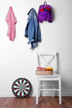 baseboard: Children things hanging on wall and stacked in room