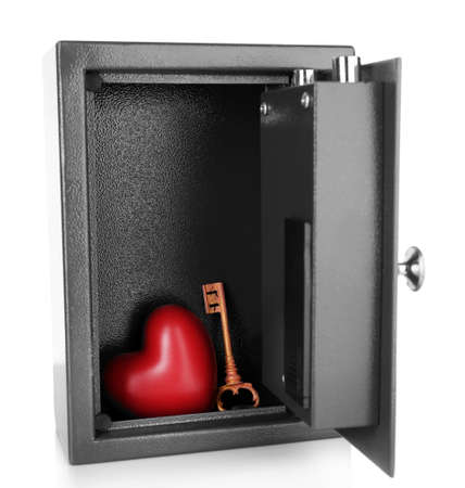 safe box: Decorative heart with key in safe isolated on white